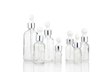Clear glass bottle with dropper